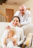 Счастливые родители с дочью Стоковые Изображения RF