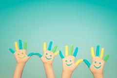 Счастливые руки smiley Стоковое Изображение