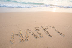 Счастливые слова на пляже Стоковое фото RF