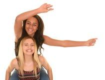 Счастливые, усмехаясь девочка-подростки Стоковые Изображения