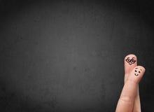 Счастливые smileys пальца с пустым экземпляром размечают темную предпосылку Стоковая Фотография RF