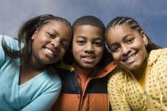 Счастливый Афро-американский усмехаться брата и сестер Стоковая Фотография
