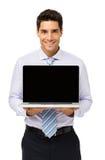 Счастливый бизнесмен повышая компьтер-книжку стоковое изображение