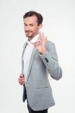 Счастливый бизнесмен показывая одобренный знак Стоковое фото RF
