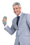 Счастливый бизнесмен поднимая тяжелые гантели Стоковые Изображения RF