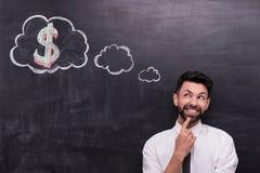 Счастливый бизнесмен при знак доллара покрашенный дальше Стоковое Фото