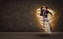Счастливый бизнесмен скача в концепцию торнадо Стоковая Фотография