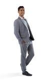 Счастливый бизнесмен стоя на белой предпосылке Стоковые Фото