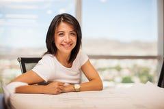 Счастливый женский архитектор на работе Стоковые Изображения RF