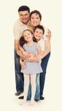 Счастливый желтый цвет семьи тонизировал 4 люд Стоковая Фотография RF