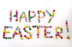 Счастливый знак пасхи покрашенных конфет шоколада Стоковые Изображения RF