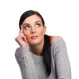 Счастливый изолированный daydreaming молодой женщины Стоковое Изображение RF