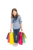 Счастливый и молодой смеяться над девушки покупок Стоковые Фото