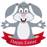 Счастливый кролик зайчика пасхи с лентой Стоковое Фото