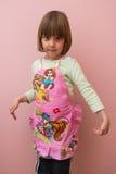 Счастливый маленький шеф-повар на розовой предпосылке Стоковое фото RF