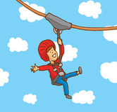 Счастливый мальчик наслаждаясь zipline Стоковые Фото
