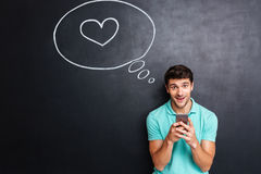Счастливый молодой человек влюбленн в пузырь речи Стоковые Фотографии RF