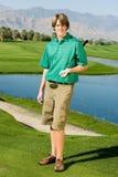 Счастливый молодой человек с гольф-клубом стоковая фотография rf