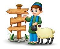 Счастливый мусульманский ребенк держа овец с пустым деревянным знаком стрелки иллюстрация штока