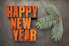Счастливый Новый Год в деревянном типе - поздравительной открытке Стоковое Изображение