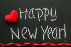Счастливый Новый Год написанный на классн классном Стоковые Изображения RF
