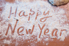 Счастливый Новый Год написанный на муке, стоковые изображения rf