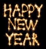 Счастливый Новый Год сделанный sparkles на черноте Стоковые Изображения