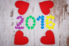Счастливый Новый Год 2016 сделал красочных сердец и красных деревянных сердец Стоковое Изображение RF