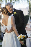 Счастливый отец обнимая дочь Стоковое Изображение