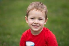Счастливый ребенок на луге Стоковая Фотография RF