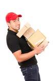 Счастливый дружелюбный уверенно носить работника доставляющего покупки на дом Стоковое Изображение RF