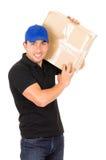 Счастливый дружелюбный уверенно носить работника доставляющего покупки на дом Стоковая Фотография