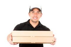 Счастливый дружелюбный уверенно носить работника доставляющего покупки на дом Стоковые Изображения