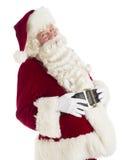 Счастливый Санта Клаус с руками на животе стоковые изображения rf