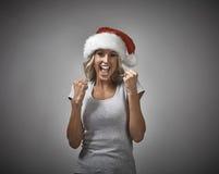 Счастливый смеясь над портрет крышки santa девушки Стоковое Фото