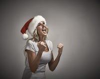 Счастливый смеясь над портрет крышки santa девушки Стоковые Фото