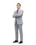 Счастливый усмехаясь бизнесмен в костюме стоковые фотографии rf