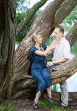 Счастливый человек и женщина около озера Стоковое фото RF