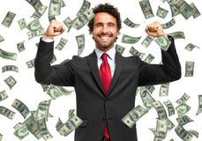 Счастливый человек наслаждаясь дождем денег Стоковое Фото