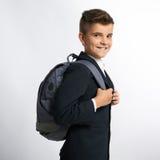 Счастливый школьник с schoolbags Стоковое фото RF