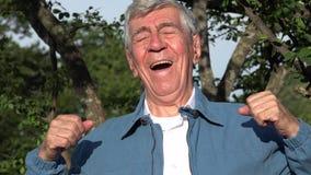 Счастливый excited старик Outdoors Стоковые Изображения RF
