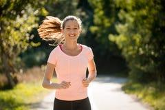 Счастливый jogging в парке Стоковые Фотографии RF
