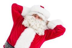 Счастливый santa лежа и ослабляя Стоковое Изображение