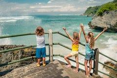 3 счастливых дет играя на пляже Стоковое фото RF