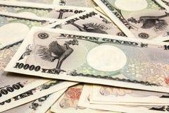 10 счетов японских иен тысяч Стоковое фото RF