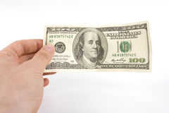счет доллара 100 в руке Стоковые Фотографии RF
