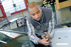 Счищатель лобового стекла ` s автомобиля отладки Стоковое Фото