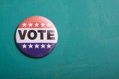 США голосуя Pin на флаге Стоковое Изображение