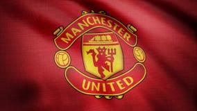 США - НЬЮ-ЙОРК, 12-ое августа 2018: Развевая флаг Манчестера Юнайтеда FC Конец-вверх развевая флага с Манчестером Юнайтедом f C стоковое изображение rf