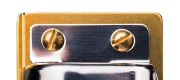 Съемка макроса золото-покрытые головки винта Стоковая Фотография